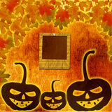 Festive pumpkin Halloween Day on the abstract paper background. With autumn leaves Stock Images