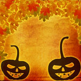 Festive pumpkin Halloween Day on the abstract paper background. With autumn leaves Royalty Free Stock Photography