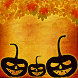 Festive pumpkin Halloween Day on the abstract paper background. With autumn leaves Royalty Free Stock Photo