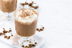 festive pumpkin latte and almond cookies on a white background Stock Photos