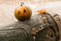 Festive pumpkins for Halloween is on a log Stock Photo