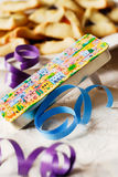 Festive Purim Scene. Traditional noisemaker (called a grogger) and hamantaschen cookies for the Jewish festival of Purim Stock Photography