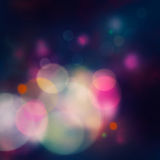 Festive purple background. Purple Festive Christmas elegant abstract background with bokeh lights and stars Royalty Free Stock Images