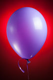Festive purple balloon Stock Images