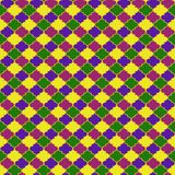 Mardi Gras Quatrefoil Seamless Pattern. Festive quatrefoil design in Mardi Gras colors Royalty Free Stock Image