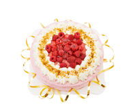 Festive raspberry cake. Celebrating a special day with raspberry cake and golden ribbons. Isolated over white royalty free stock photo