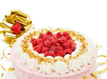 Festive raspberry cake. For the celebration of birthdays or anniversaries. With golden bow and red heart decorations. Isolated on white stock photo