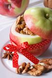 Festive red apple stuffed with nuts and raisins vertical Royalty Free Stock Photo