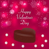 Festive red background with a chocolate candy in the form of hearts, pearls and inscription Stock Image