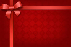 Festive red background with red ribbon. Festive red background with shiny red ribbon and bow Stock Photos