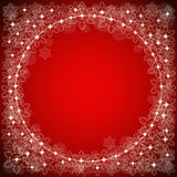 Festive red background. With space for text in the center and a pattern of snowflakes on the edges Royalty Free Stock Photography