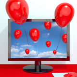 Festive Red Balloons In The Sky And Coming Out. Of Screen For Online Celebrations Royalty Free Stock Image