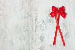 Festive red bow with a ribbon Stock Image