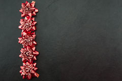 Festive red bows Stock Images