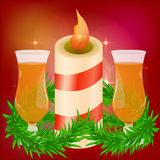 Festive red bright background. Beautiful candle. Branches of trees. Preparing for Christmas. Romantic evening. Glasses of champagne, wine, drink. St Royalty Free Stock Images