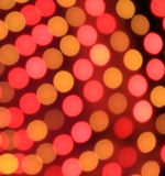 Festive red and orange background with boke effect Stock Image