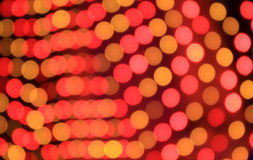 Festive red and orange background with boke effect Stock Images