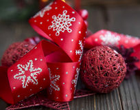 Festive Red Ribbon and Christmas Ball Stock Photo