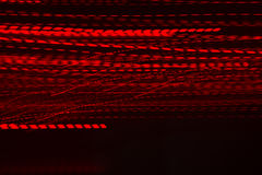 Festive red sparkling wallpaper. Luxury holiday blur abstract background with disco light royalty free stock photo