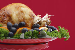 Festive Red Theme Thanksgiving Christmas Turkey Platter. Red and white theme Thanksgiving Table setting with Roast Turkey Chicken on large platter centerpiece Royalty Free Stock Image