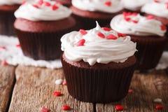 Festive red velvet cupcakes decorated with hearts macro. horizon Royalty Free Stock Photo