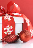 Festive red and white theme Christmas gift box - closeup. Royalty Free Stock Images