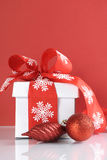 Festive red and white theme Christmas gift box - vertical. Royalty Free Stock Photography