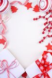 Festive red and white theme Christmas Holiday background. Bright festive red and white theme Christmas Holiday background with decorated borders on white wood stock images