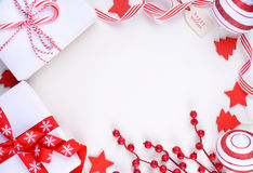 Festive red and white theme Christmas Holiday background. Bright festive red and white theme Christmas Holiday background with decorated borders on white wood Royalty Free Stock Images