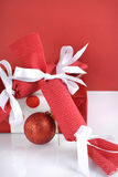 Festive red and white theme handmade fabric Christmas bon bon crackers - vertical closeup. Royalty Free Stock Photo