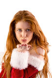 Festive redhead blowing a kiss Stock Images