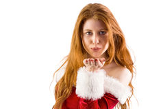 Festive redhead blowing a kiss Royalty Free Stock Photography