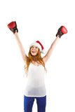 Festive redhead cheeering with boxing gloves Stock Photography