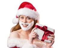 Festive redhead in foam beard holding gift Royalty Free Stock Photo