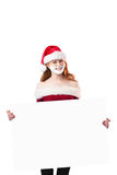 Festive redhead in foam beard holding poster Royalty Free Stock Images
