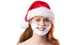 Festive redhead in foam beard Stock Photography
