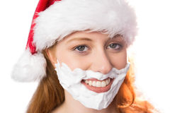Festive redhead in foam beard Stock Image