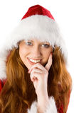 Festive redhead with hand on chin Stock Images