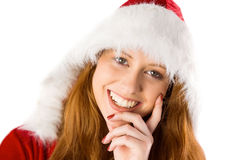 Festive redhead with hand on chin Royalty Free Stock Image