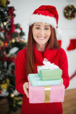 Festive redhead holding christmas gifts Royalty Free Stock Images
