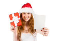 Festive redhead holding a gift Stock Photography