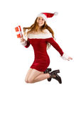 Festive redhead jumping with gift Royalty Free Stock Photos