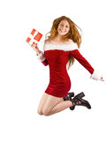 Festive redhead jumping with gift Royalty Free Stock Photo