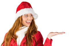 Festive redhead presenting with hand Royalty Free Stock Photography