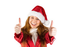 Festive redhead showing thumbs up Royalty Free Stock Photo