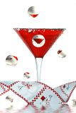 Festive Reflection. Festive martini glass and ribbon reflected in bubbles Stock Image