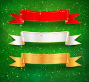 Festive ribbon banners. Festive satin ribbon banners with gold garland decoration on green grunge watercolor background with falling snow and light sparkles Royalty Free Stock Images