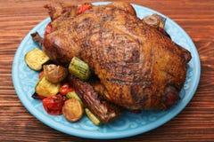 Festive roast duck with vegetables Stock Photos