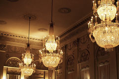 Festive Room. Festive or pompous room ceiling with large chandeliers Royalty Free Stock Images