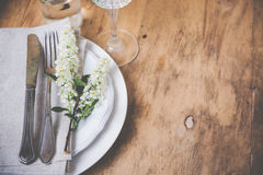Festive rustic table setting. Vintage style table decor with bird cherry blossoms and old cutlery, festive rustic table setting Royalty Free Stock Photo